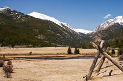 Colorado mountain valley. Mountain valley in Colorado with snow-capped mountains in the background on a sunny spring day Stock Image