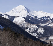 Colorado Mountain Wilderness. A view of Mt. Daly in the Elk mountain range in Colorado. A view of wilderness capped with a snow-covered peak Stock Images
