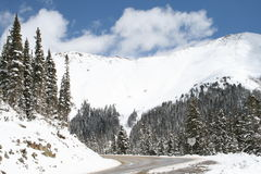 Colorado Mountains in fresh snow. Colorado Mountains after a fresh snowstorm and the road is made passable Stock Photography