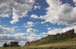Colorado mountainside house. Devils backbone clouds home landscape Stock Photography