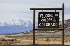 Colorado and New Mexico Border. This is a sign at the Colorado and New Mexico boarder. this is showing the snow capped mountains in the background stock images