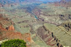 The Colorado River Cuts A Deep Grove Into the Grand Canyon of Arizona. The blue turbulent waters of the Colorado River cuts a grove into the depths of the Grand stock photos