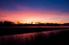 Colorado River at Dawn. Horsethief Canyon State Wildlife Area in western Colorado has scenic views, migratory birds, and diverse wildlife.  Riparian landscape Royalty Free Stock Photos