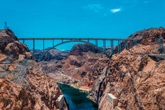 Colorado River and Hoover Dam. Tourist attraction of Nevada and Arizona, USA. The Hoover Dam and the arch bridge over the Colorado River Stock Photo