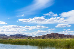 Colorado river and mountains under blue sky. In Yuma Arizona Royalty Free Stock Photo