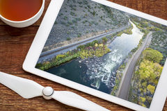 Colorado RIver rapid aerial view. Rodeo Rapid on the upper Colorado River at Burns, Colorado, USA, - reviewing and editing aerial image on a digital tablet stock photos
