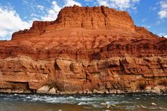 Colorado river rapids at Lees Ferry and chocolate cliff Stock Image