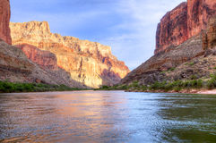 Colorado River. Reflection in Colorado River of Butte catching days last rays, in Grand Canyon Royalty Free Stock Image