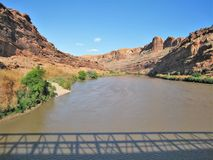 Colorado River Shadows. The Colorado Riverway Bridge casts its shadow on the Colorado River running through the canyon just northeast of Moab, Utah Stock Photography