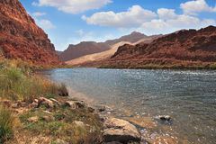 The Colorado River among the steep mountains Stock Photo