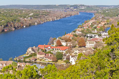 Colorado river taken from Mount Bonnell. Colorado river with houses, tree and bridge at background Royalty Free Stock Image