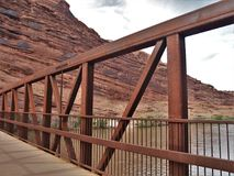 Colorado Riverway Bridge. Completed in May 2008, the Colorado Riverway Bridge in Moab, Utah provides a safe crossing over the Colorado River for hikers and Royalty Free Stock Photography