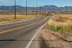 Colorado road to Boulder city. Road in Colorado on the way to Boulder city and view of the mountains Royalty Free Stock Photos