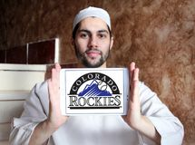 Colorado Rockies baseball team logo. Logo of Colorado Rockies baseball team on samsung tablet holded by arab muslim man. The Colorado Rockies are an American royalty free stock image