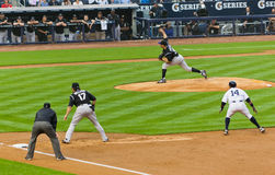 Colorado Rockies x New York Yankees Baseball. Ubaldo Jimenez pitching.Todd Helton and Curtis Granderson are on the second base Stock Image