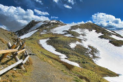 Colorado Rocky Mountain Path and Snow Covered Peak Royalty Free Stock Image