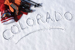 Colorado ski vacation concept, word written in snow with skiing equipment Royalty Free Stock Image