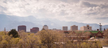 Colorado Springs Downtown City Skyline Dramatic Clouds Storm App. Spring time in Colorado storm in the mountains Stock Photography