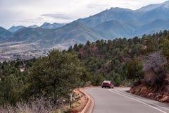 Colorado springs garden of the gods rocky mountains adventure travel photography. Car driving on road through the garden of the gods in colorado springs - travel royalty free stock photography