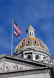Colorado State Capitol. Gold leafed dome of the Colorado state capitol in Denver. The United States flags fly in the foreground stock photos