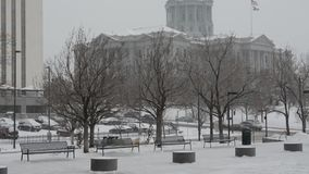 Colorado State Capitol Building in Snow storm. Tilt shot of the Colorado State Capitol during a blizzard stock video