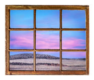Colorado sunset sky as seen through old window Royalty Free Stock Photography
