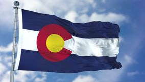 Colorado Waving Flag. Colorado U.S. state flag waving against clear blue sky, close up, isolated with clipping path mask luma channel, perfect for film, news royalty free stock photography