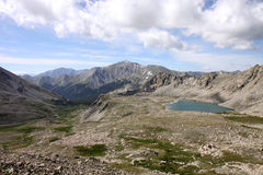 Colorado Wilderness. Looking over Colorado's rugged wilderness area in a valley with a high mountain lake Stock Photos