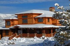 Colorado winter home. Huge Colorado winter home during snow season Royalty Free Stock Photography