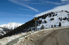 Colorado winter road. Icey road curve in Colorado high country in winter Stock Images