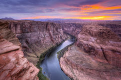 Coloradofloden hästskokrökning på solnedgången Fotografering för Bildbyråer