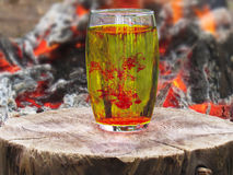 Colorant in a lemonade. On a background of campfire Royalty Free Stock Photography