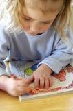 Coloration dans le livre Photographie stock