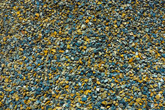 Colore della pietra sulla terra Immagini Stock