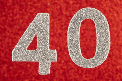 Colore di bianco di numero quaranta sopra un fondo rosso anniversario fotografia stock