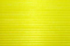 Colore giallo dei tessuti ondulati astratti del fondo 3D Immagini Stock