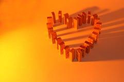 Colore giallo del cuore di domino Fotografia Stock