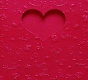 Colore metallico di forma rossa del cuore, biglietto di S. Valentino della carta sul fiore di struttura Immagini Stock Libere da Diritti