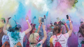 Colore Mulhouse 2017, the annual running of five kilometers with colored powder jets. MULHOUSE - France - 4 June 2017 - Closeup of people back Throw powder of royalty free stock photography
