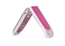 Colore rosa del telefono mobile su una priorità bassa bianca Fotografia Stock Libera da Diritti