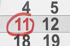 Colore rosso Contrassegno sul calendario a 11 Immagine Stock Libera da Diritti