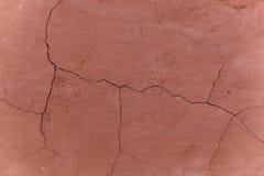 Colore rosso della parete con le crepe Immagine Stock