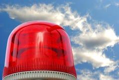 Colore rosso della sirena sui precedenti del cielo Fotografia Stock