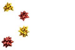 Colore rosso e cartoline di Natale dell'arco dell'oro Fotografie Stock