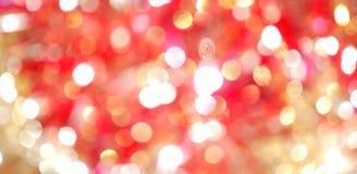 Colore rosso e sfuocatura dell'indicatore luminoso dell'oro Fotografia Stock
