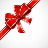Colore rosso ed arco del regalo dell'oro Fotografia Stock