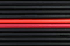 Colore rosso in matite nere Immagini Stock Libere da Diritti