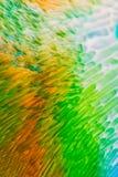 Colore scorrente del fondo astratto attraverso latte Fotografie Stock