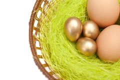 Colored �aster eggs are in wattled basket Royalty Free Stock Images