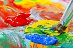 Colored Acrylic Paint And Brush Close-up Royalty Free Stock Images